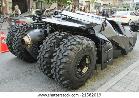 TORONTO, CANADA, JULY 11, 2008 - The batmobile featured in the Batman sequel The Dark Knight draws the crowds in the city streets during a promotional drive.