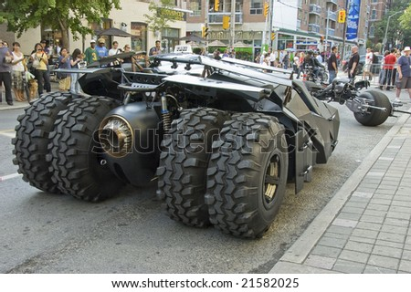 TORONTO, CANADA, JULY 11, 2008 - The batpod motorcycle and the batmobile used in the Batman sequel The Dark Knight touring the city for a promotional campaign.
