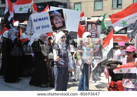 TORONTO, CANADA – JULY 9:  Unidentified Syrians in Canada gather at the Eaton Centre for a rally for Syrian freedom rally on July 9, 2011 in Toronto, Ontario Canada.