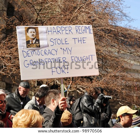 TORONTO, CANADA - MAR 31:  Protesters gathered to protest the alleged election fraud committed by the Conservatives in the last Canadian federal election Mar 31, 2012 in Toronto, Ontario.