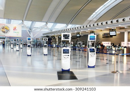 TORONTO, CANADA - MAY 29, 2014: Self-service check-in kiosks and check-in counters at Pearson International Airport in Toronto, Ontario, Canada. Pearson is the largest and busiest airport in Canada.