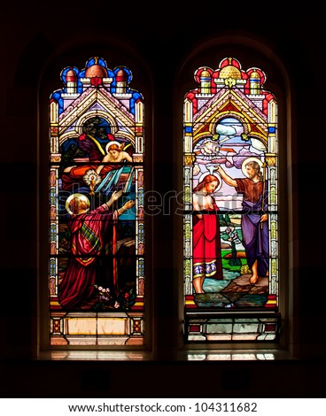 TORONTO, CANADA - MAY 26: The stained glass windows with religious motifs at Corpus Christi church in Toronto on May 26, 2012