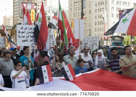 TORONTO, CANADA – MAY 21:  Unidentified Syrians in Canada gather at the Eaton Centre for a rally for Syrian freedom on May 21, 2011 in Toronto, Ontario Canada.