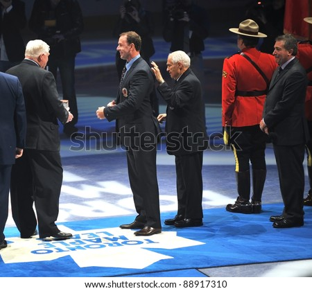 TORONTO, CANADA - NOV 13:  Joe Nieuwendyk is given his Hall of Fame blazer before the Hockey Hall of Fame Legends Classic game on Nov 13, 2011 Air Canada Centre in Toronto, Canada.