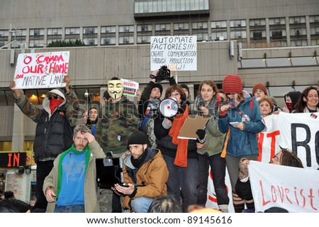TORONTO, CANADA – NOV 19:  Occupy protesters gather in front of City Hall to protest Mayor Ford's proposed cuts and his attempt to evict them from Saint James Park Nov 19, 2011 in Toronto.