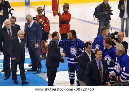TORONTO, CANADA – NOV 13: Recent HHOF inductees are congratulated by other former NHL players at the Hockey Hall of Fame Legends Classic game on Nov 13, 2011 in Toronto, Canada.