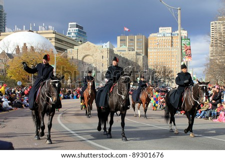 TORONTO, CANADA – NOVEMBER 20: Royal Mounted police at Christmas Parade  November 20, 2011 in Toronto Downtown, Canada
