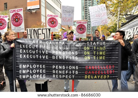 TORONTO, CANADA – OCT 15:  Unidentified CUPE members protest Air Canada's stance against their demands at Saint James Park in downtown Toronto, Toronto version of Occupy Wall Street, Oct. 15 2011.