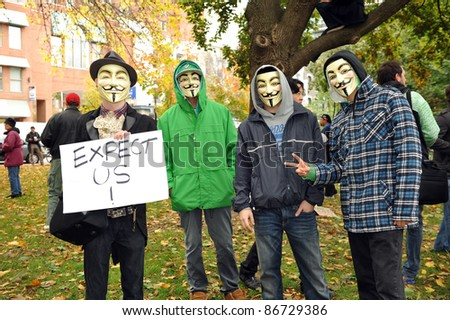 TORONTO, CANADA – OCT 15:  Unidentified demonstrators in Guy Fawkes masks gathered at Saint James Park in downtown Toronto, for the Toronto version of Occupy Wall Street, Oct. 15 2011.