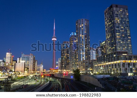 TORONTO, CANADA - OCTOBER 8, 2013: An urban scene from Toronto showing the CN Tower, Skyscrapers and Condos at night