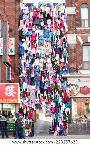 TORONTO, CANADA - OCTOBER 11, 2014: Made in China, a work of art by Maria Ezcurra  in Chinatown celebrating the Nuit Blanche of Scotia Bank. The work represent the connection between two cultures.