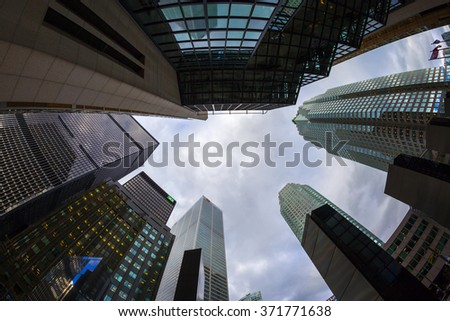 TORONTO CANADA 16-10-2015:Office buildings stretch up to the blue sky in the financial district in downtown. Toronto has prominent buildings in a variety of styles by many famous architects. #371771638