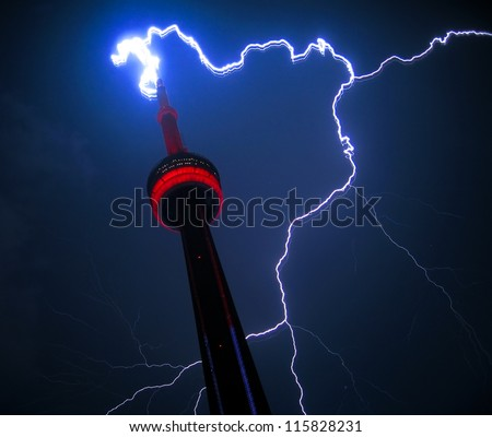 TORONTO, CANADA - SEP 1 2011: Dramatic real lightning striking the largest structure in North America, the CN Tower in Toronto, Canada. Sept 1 2011 - stock photo