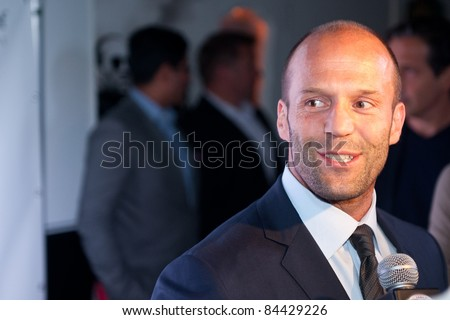 "TORONTO, CANADA – SEPT 10:  Jason Statham is interviewed at the ""Killer Elite"" reception after the movie premiere at the Toronto International Film Festival September 10, 2011 Toronto, Ontario. - stock photo"