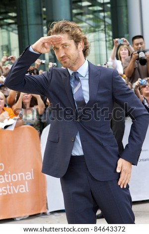 "TORONTO, CANADA - SEPTEMBER 11: Actor Gerard Butler arrives at the gala screening of the movie ""Machine Gun Preacher"" at the 2011 Toronto International Film Festival on Sept. 11, 2011 in Toronto, Canada."