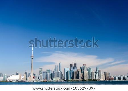 Toronto city skyline on clear sunny day.