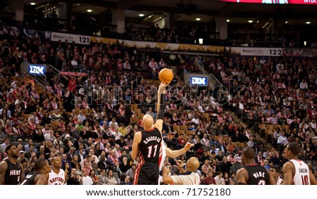 TORONTO - FEBRUARY 16: Tipoff at an NBA basketball game at the Air Canada Centre on February 16, 2011 in Toronto, Canada.  The Miami Heat beat the Toronto Raptors 103-95.