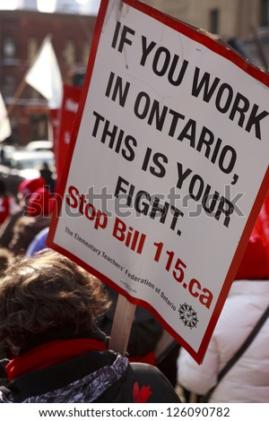 TORONTO - JAN  26 : Poster close-up. Elementary teachers protest Bill 115 on January 26 2013   in Toronto,  Canada.