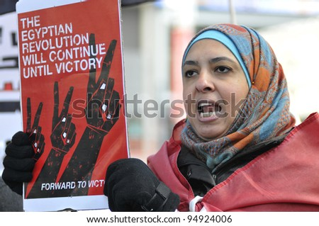 TORONTO - JANUARY 21:   An Egyptian woman participating in a rally at Yonge and Dundas square during the global day of support for the Egyptian revolution on January 21 2012 in Toronto, Canada. - stock photo