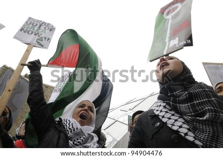 TORONTO - JANUARY 10:  Angry young Arab teens chanting slogans against Israeli atrocities  during a rally to condemn the Israel occupation on Gaza on January 10 2009 in Toronto, Canada.