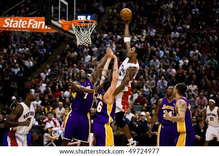 TORONTO - JANUARY 24: Chris Bosh #4 participates in an NBA basketball game at the Air Canada Centre on January 24, 2010 in Toronto, Canada.  The Toronto Raptors beat the Los Angeles Lakers 106-105. - stock photo