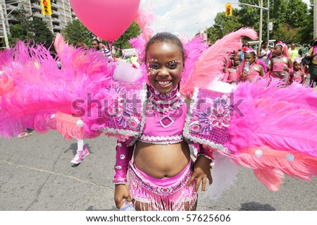 TORONTO - JULY 17: A  smiling participant during the Junior Caribana Parade on  July 17, 2010 in Toronto.