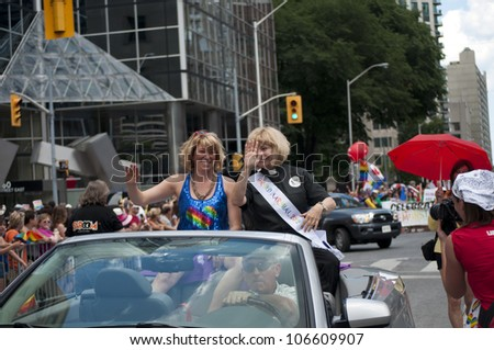 TORONTO-JULY 1: Cheri DiNovo and Laurel Broten during the 32 Pride Parade which celebrates the history, diversity and future of the  gay community as seen on July 1, 2012 in Toronto