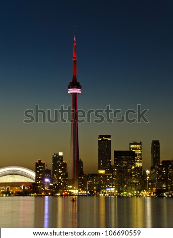 TORONTO - JULY 2: CN Tower at Night. One of the highest structures in the world and a tourist landmark as shown on July 2, 2012 in Toronto