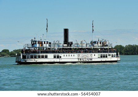 """TORONTO - JULY 01: Double deck double ended paddle steamer """"Trillium"""" operates as ferry on Canada Day in Toronto, July 01, 2010"""