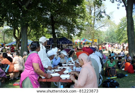 TORONTO – JULY 17:  Participants eating at 39th Annual festival of India in July 17 2011 on Central Island in Toronto, Canada. The festival is a popular annual attraction  for the last 39 years.
