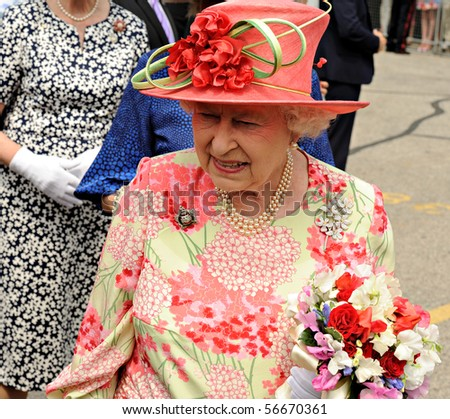 TORONTO-JULY 06: The Queen, dressed in a bright pink hat with a light green ribbon and a matching patterned dress, smiled and chatted with many in the crowd in Toronto, july 06, 2010