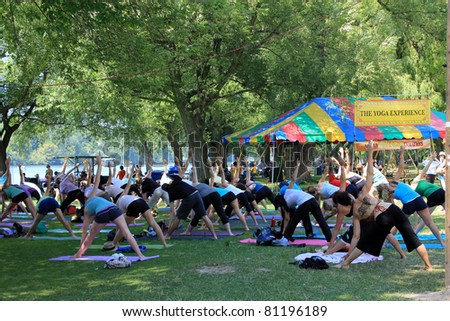 TORONTO – JULY 17:  Yoga at 39th Annual festival of India in July 17 2011 on Central Island in Toronto, Canada. The festival is a popular annual tourist attraction  for the last 39 years. - stock photo