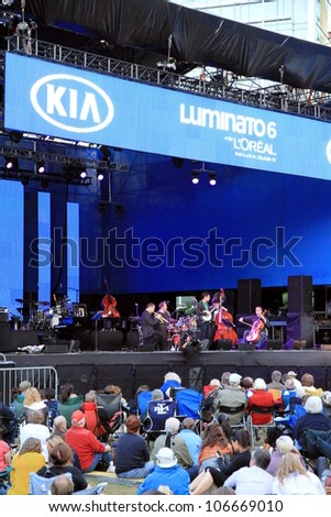 TORONTO - JUNE 13: A concert of the annual Luminato Festival on June 13, 2012 in Toronto. Luminato events take place in multiple indoor and outdoor locations throughout Toronto downtown core.