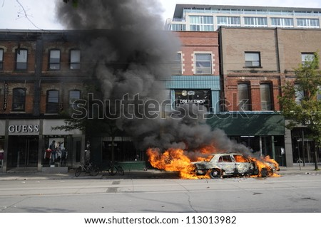 TORONTO-JUNE 26:  A police car burning on queen street during the G20 Protest on June 26, 2010 in Toronto, Canada.
