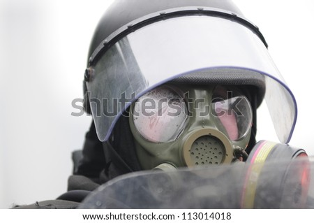 TORONTO-JUNE 26:  A police officer with gas masks and ready for any chemical or gas bombs during the G20 Protest on June 26, 2010 in Toronto, Canada. - stock photo