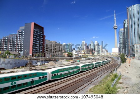 TORONTO - JUNE 29: A view of Downtown and the Go Transit railway on June 29, 2012 in Toronto. GO Transit carries over 217,000 passengers every weekday and 57 million annually. - stock photo