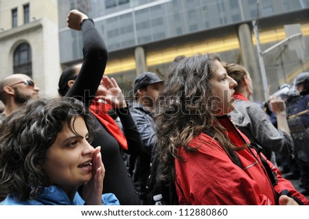 TORONTO-JUNE 26:   Activists chanting slogans during the G20 Protest on June 26, 2010 in Toronto, Canada. - stock photo