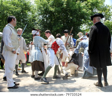 TORONTO – JUNE 19: Actors and actresses at reenactment of Revolutionary War between refugees and Loyalists at  Black Creek -  on June 19, 2011 in Black Creek Village, Toronto