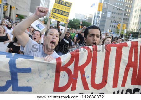 TORONTO-JUNE 28:  Agitated activists shouting and yelling during the G20 Protest on June 28, 2010 in Toronto, Canada.