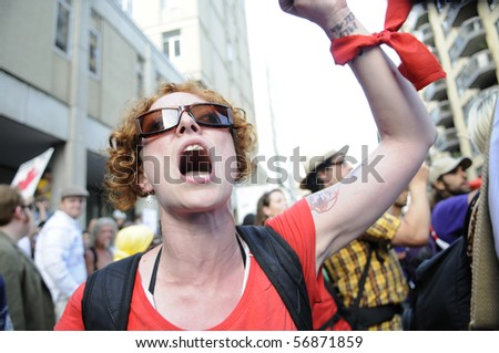TORONTO-JUNE 25:  An angry anti- capitalist protester after being blocked by the Police from entering the summit perimeter, during the G20 Protest on June 25, 2010 in Toronto, Canada. - stock photo