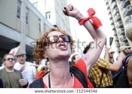 TORONTO-JUNE 25: An angry protester chanting slogans   during the G20 Protest on June 25  2010 in Toronto, Canada.