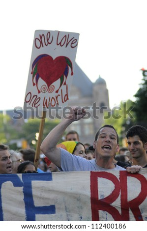 TORONTO-JUNE 28:  Angry protestors chanting slogans during a protest rally to denounce the mass arrest of the police  after the G20 summit on June 28, 2010 in Toronto, Canada.