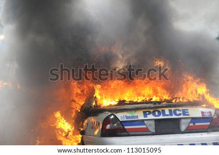TORONTO-JUNE 26:  Back side of a  burning police car during the G20 Protest on June 26, 2010 in Toronto, Canada.