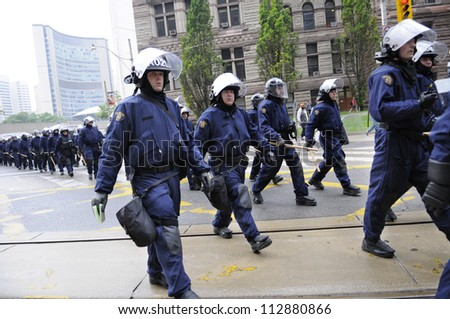 TORONTO-JUNE 26:   Elite riot police group marching on the streets during the G20 Protest on June 26, 2010 in Toronto, Canada. - stock photo