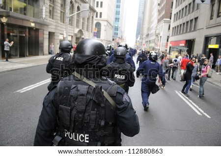 TORONTO-JUNE 26:   Elite riot police officers  marching along the streets during the G20 Protest on June 26, 2010 in Toronto, Canada.