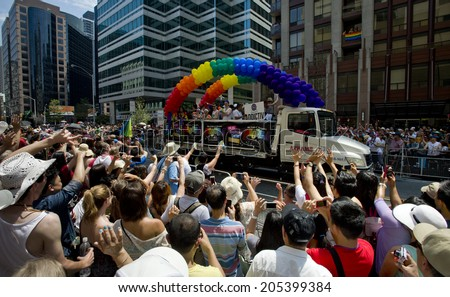 toronto - june29: festival goers hold the rainbow banner at the toronto ,canada on June 29 , 2014