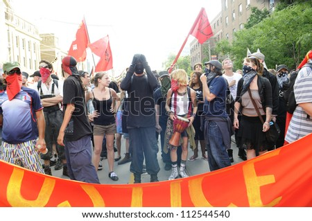 TORONTO-JUNE 26:  Masked protesters  who were later alleged of  vandalizing  during the G20 Protest on June 26 2010 in Toronto, Canada. - stock photo