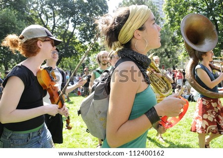 TORONTO-JUNE 25:  Members of a music band playing in a park to entertain  the mob during the G20 Protest on June 25, 2010 in Toronto, Canada.