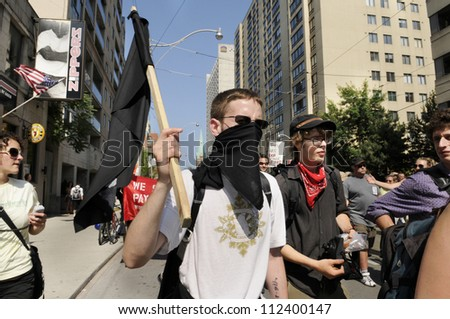 """TORONTO-JUNE 25:  Members of """"The black anarchist"""" group who was later accused of vandalizing shops and store  during the G20 Protest on June 25, 2010 in Toronto, Canada."""