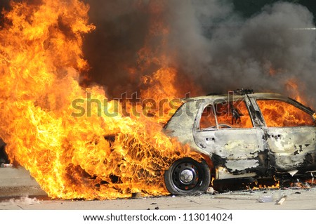 TORONTO-JUNE 26:  Parts of a police car burning after being torched during the G20 Protest on June 26, 2010 in Toronto, Canada.